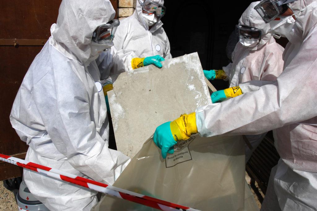 technicians removing asbestos